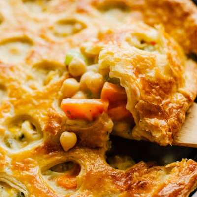 This Easy Chickpea Pot Pie is packed with a creamy vegetable filling and wrapped in a buttery crust (and best of all, you just need one pan to make it)! Your vegetarian dinner just got a lot less boring.