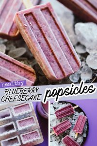 Popsicles on a plate with ice, purple background - These Blueberry Cheesecake Popsicles are a creamy and refreshing summer snack that are low in calories, ingredients, and prep time (but certainly not low on that classic blueberry cheesecake flavor!) Dig out your popsicle mold and give these a go.