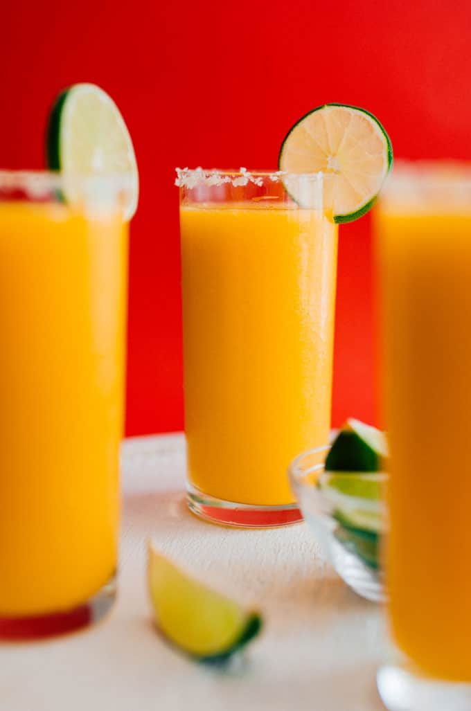 Whether you're in need or a slushy cocktail or are just trying to clean out the freezer, this Frozen Mango Margarita Slush is the refreshing cocktail you need.