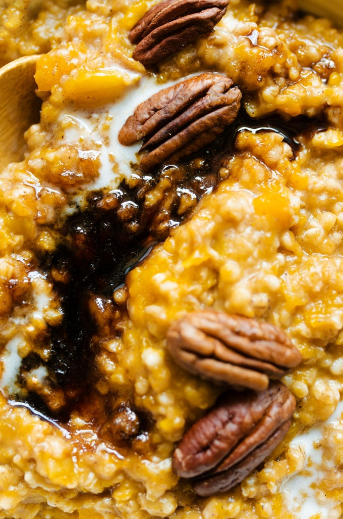 Steel cut oats with pecans and brown sugar in a bowl on yellow background