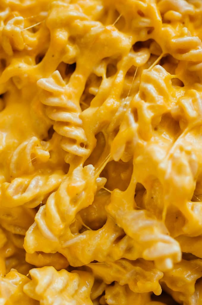 Close up of macaroni and cheese with velvety cheese sauce