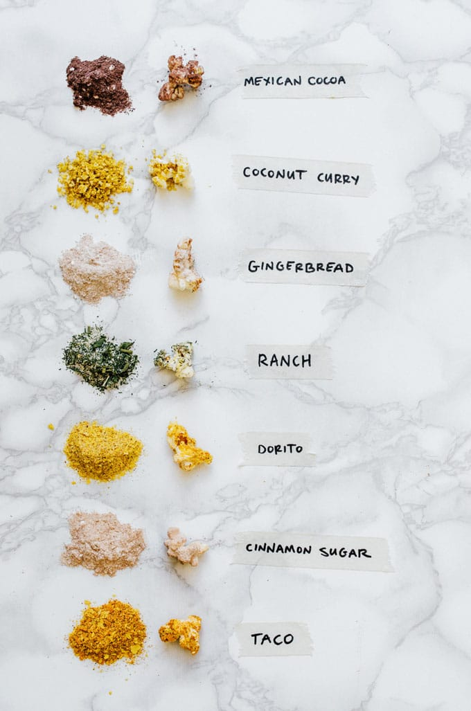 Homemade popcorn seasoning in 7 flavors with labels on a marble background