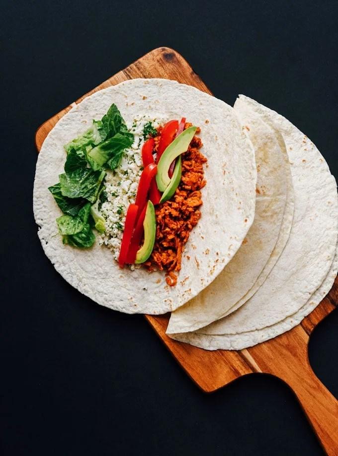 vegan burritos recipe on black background