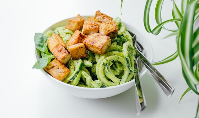 This Zucchini Noodles Vegetarian Meal Prep is a low carb lunch solution that will have you looking forward to lunchtime! Packed with fresh veggies, avocado pesto, and crispy baked tofu.