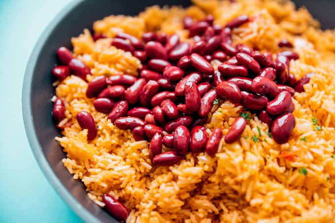 Adding beans to Spanish Rice in a pan