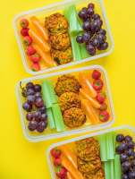 Meal prep snack boxes with fruits and veggies on a yellow background - These Meal Prep Snack Boxes are a fun and healthy snack to prepare for the week, filled with fruits, veggies, and tasty Zucchini Cheddar Bites!