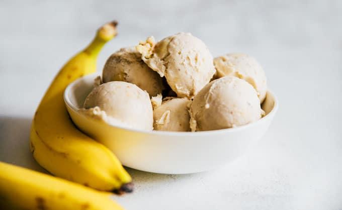 Banana nice cream recipe in a white bowl - Satisfy your sweet tooth with this creamy and customizable 1-ingredient Banana Nice Cream!