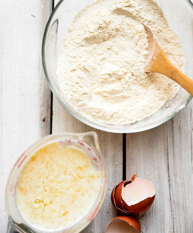 Ingredients to make the best buttermilk pancakes recipes in a bowl on a white background.