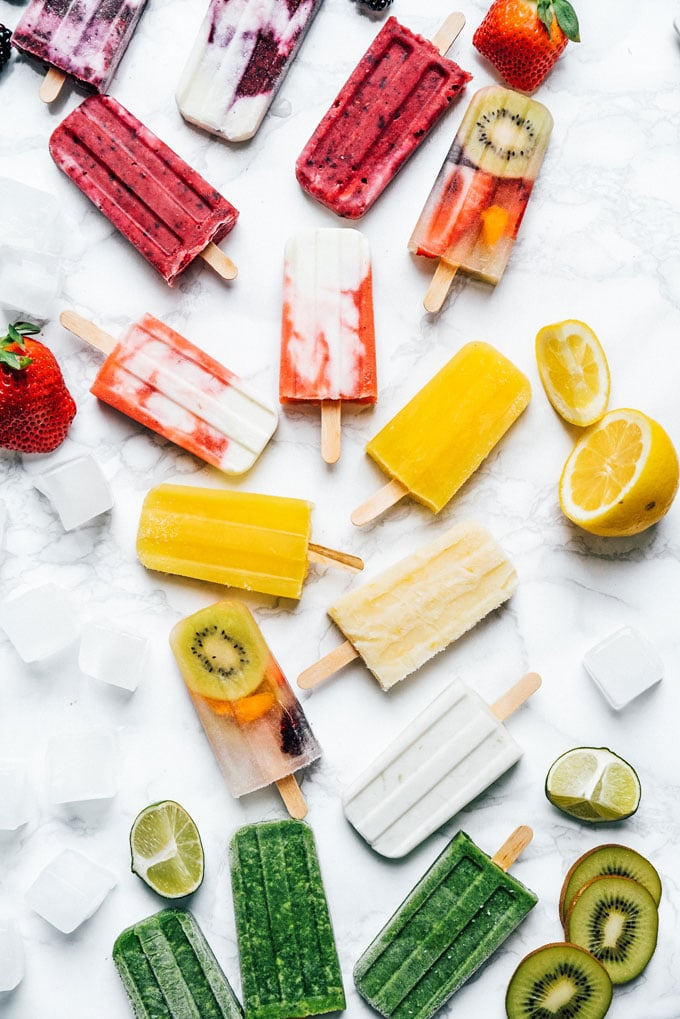 Healthy homemade rainbow popsicles recipe photo on a marble background