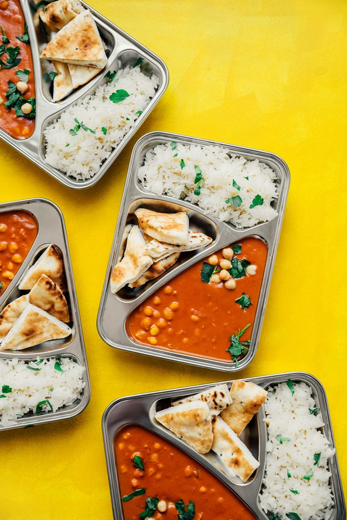 Chickpea tikka masala with naan and rice in meal prep containers