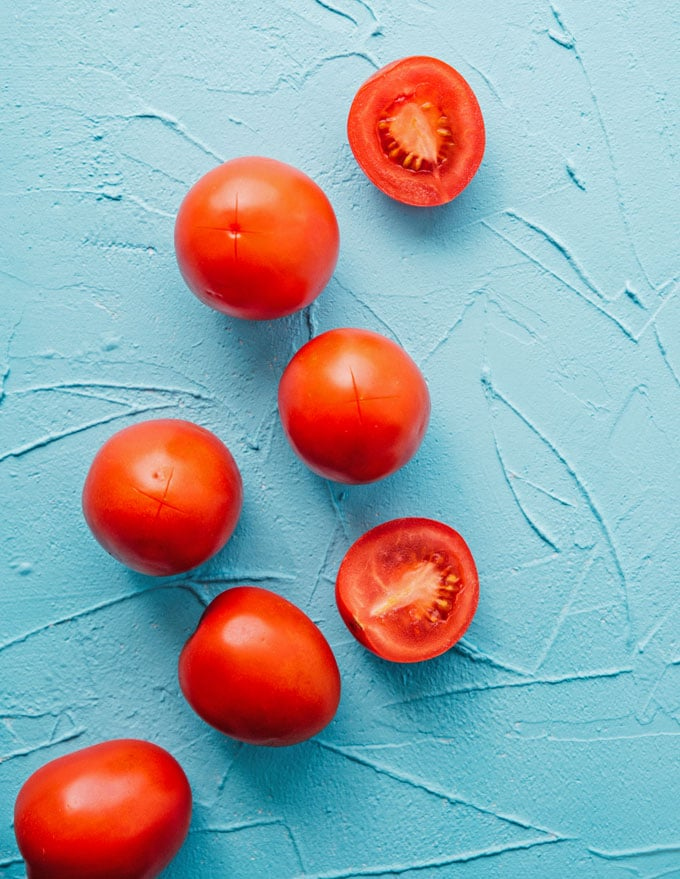 Tomatoes on a blue background
