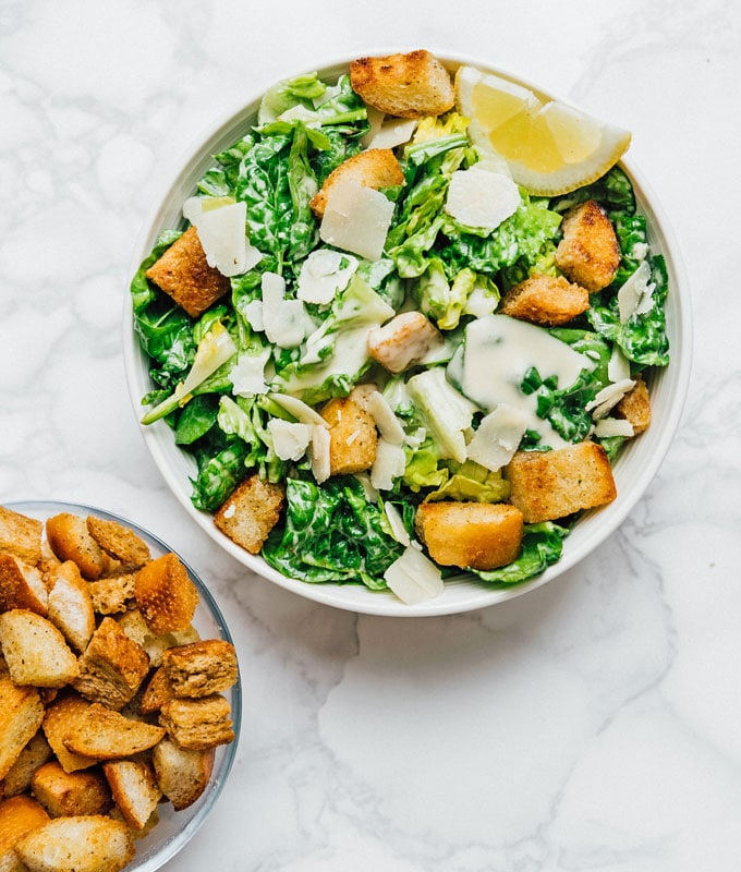 Salad on a marble background with homemade croutons