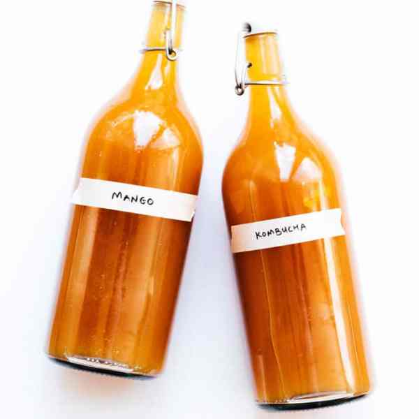 Mango kombucha in bottles