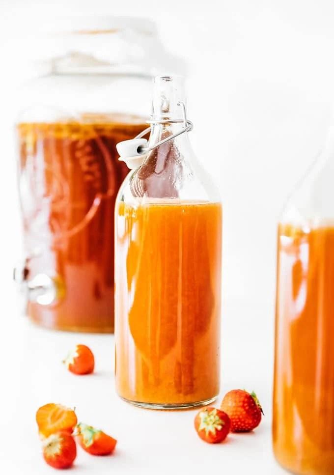 Strawberry kombucha in a fermentation bottle