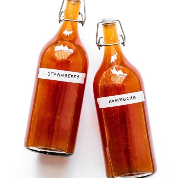 Strawberry kombucha in fermentation bottles