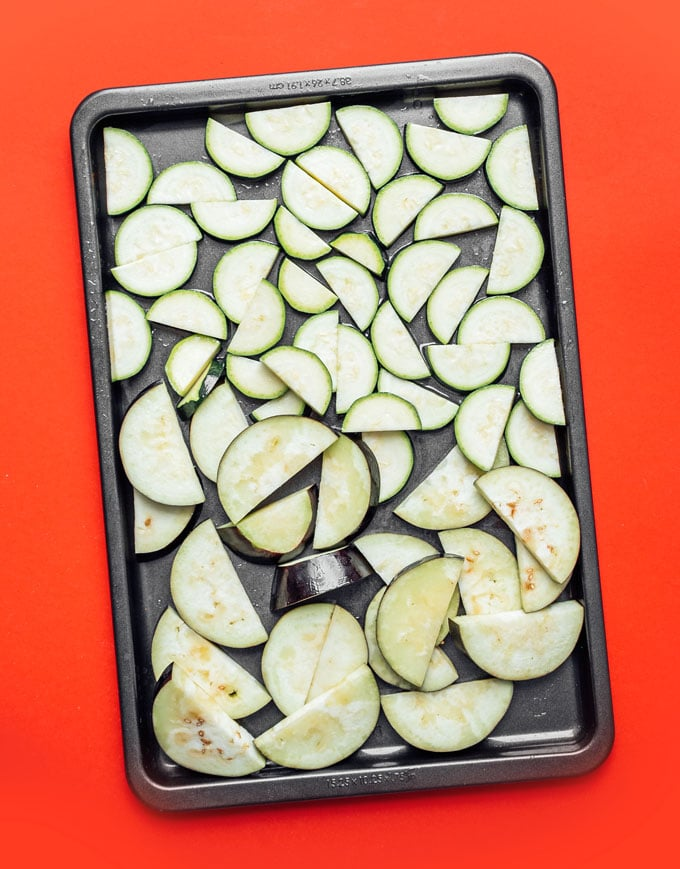 Sliced zucchini and eggplant on baking sheet