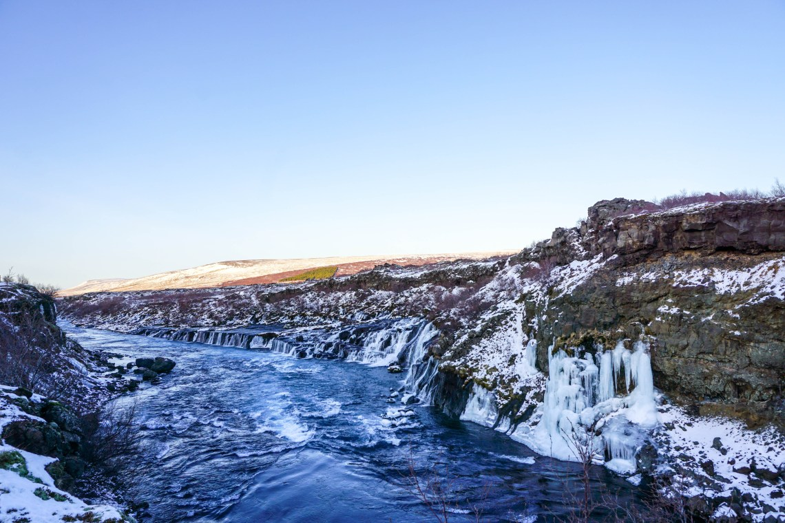 Looking for some Hidden Gems in Iceland? Get off the beaten path by visiting Hraunfossar & Barnafoss waterfalls, a quick day trip from Reykjavik! | Life With a View