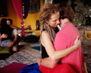 Couples perform tantric yoga hug during a tantra festival