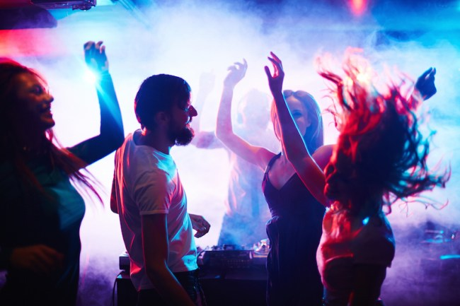 Young people dancing in nightclub, music, dance festival