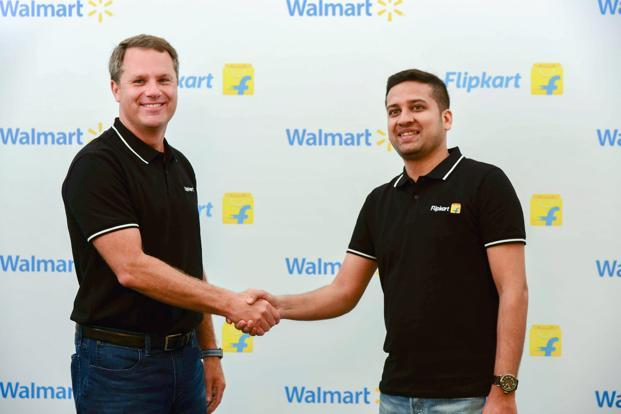 Walmart CEO Doug McMillon (left) with Flipkart co-founder Binny Bansal. Walmart is viewing Flipkart as a long-term bet that may take years, or even decades, to yield excellent financial returns. Photo: PTI