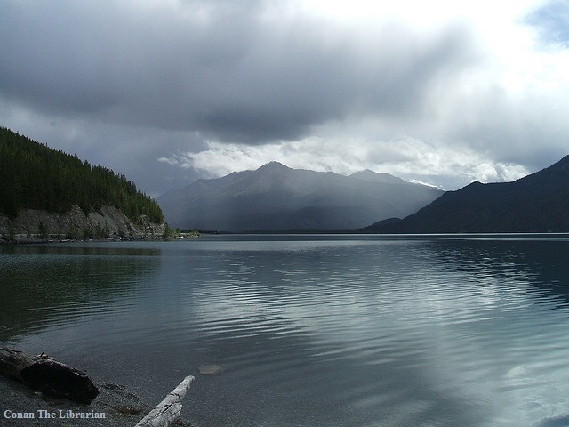 The still surface of Muncho Lake, in northern British Columbia, Canada