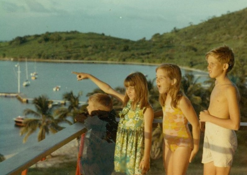 Patty points to a tourist attraction on the island of St. Croix. Each of these four children saw a living pterosaur earlier, in Cuba.