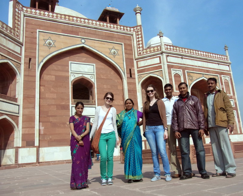 Photos to fall in love with India: Family portraits at Humayuns Tomb. We got asked to be in so many photos we ended up asking for our own in return! - LiveRecklessly.com