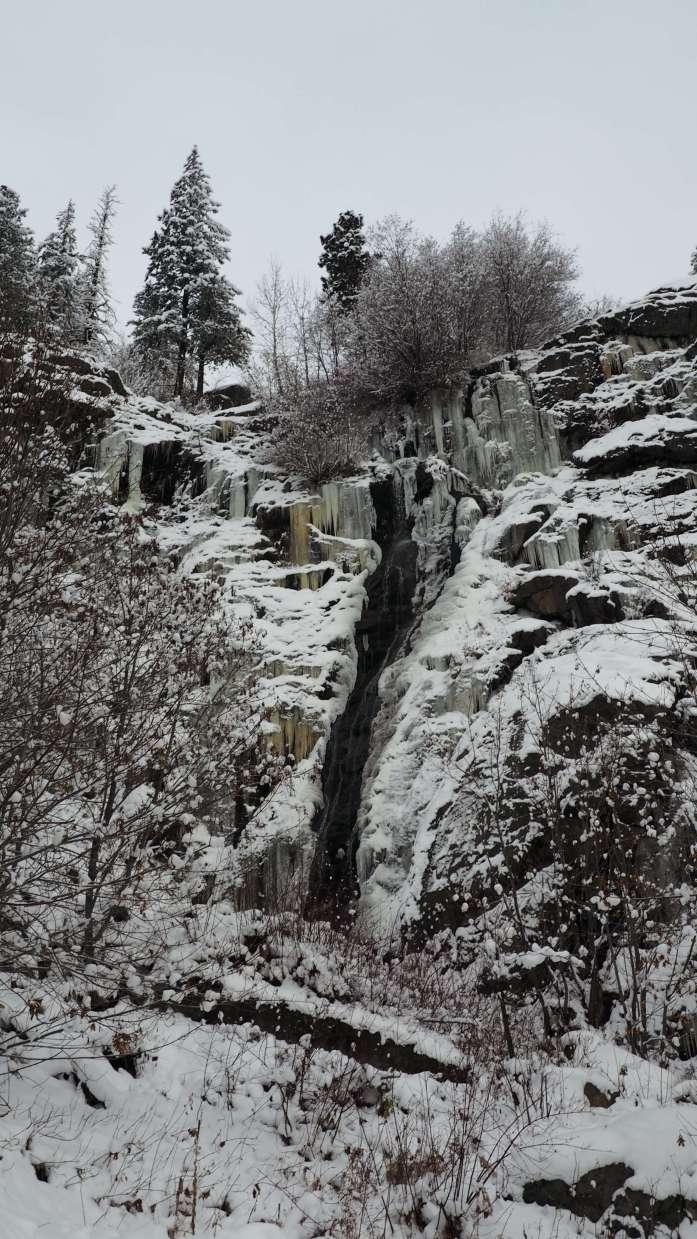 Waterfall near rustic cabin in Leavenworth Washington - Live Recklessly