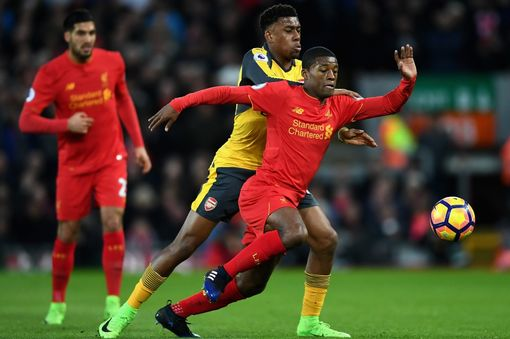 Alex Iwobi of Arsenal (L) puts pressure on Georginio Wijnaldum of Liverpool (R) during the Premier League match between Liverpool and Arsenal at Anfield on March 4, 2017 in Liverpool, England. (Photo by Laurence Griffiths/Getty Images)