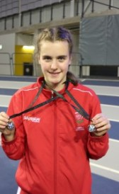 Anna Rowe with gold medals