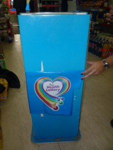 Health Lottery promo Stand with concealed counterfeit Golden Virginia 2