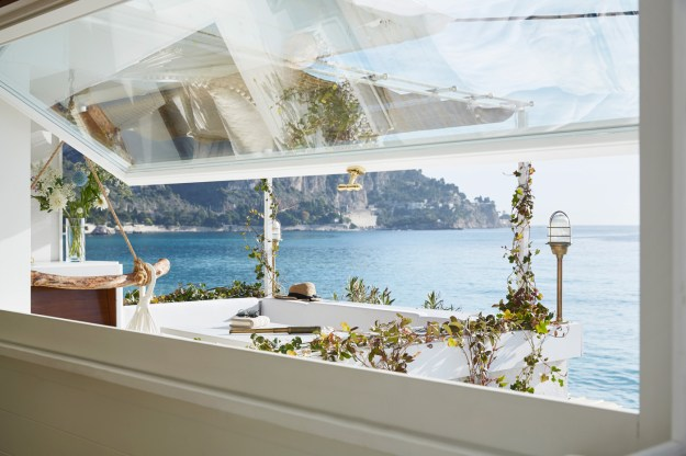 You won't want to miss the tour of this tiny seaside cottage...white walls, brass fittings, Carrara marble, and that view!