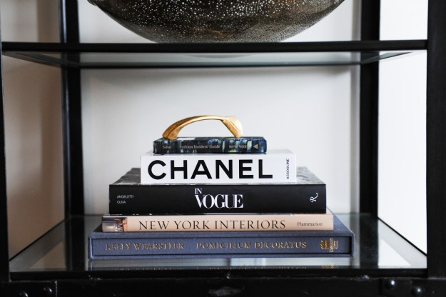 Studying Chrissy & Co's design vignettes. A chic stack of a books and a brass design object is all you need.