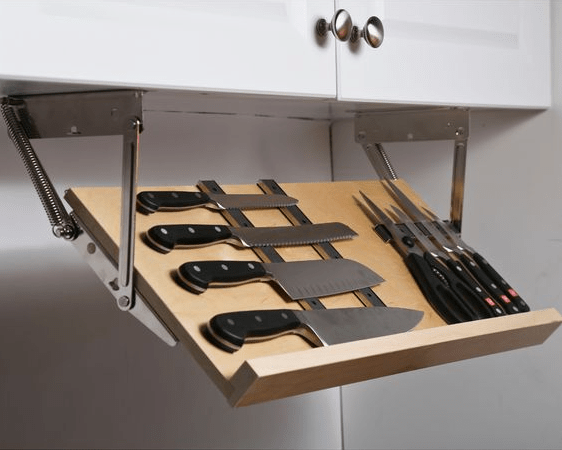 "Uber clever, customized knife storage. File under ""Dream Kitchen"" features."