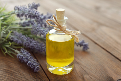 Lavender essential oil with lavender flowers