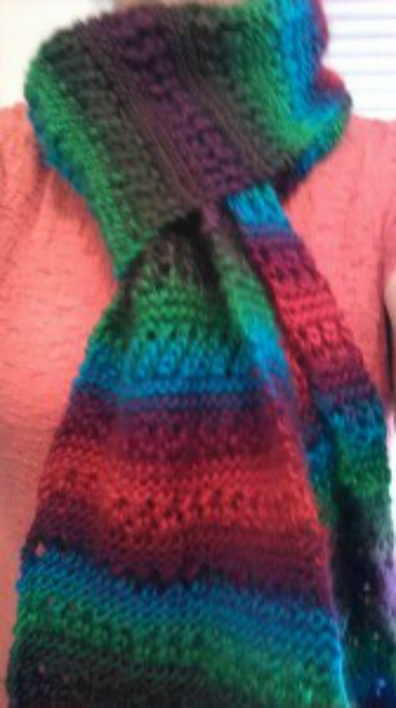 Mulit-colored scarf perfect for the fabric of the season.