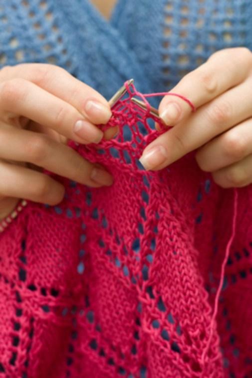 Girl knitting a scarf