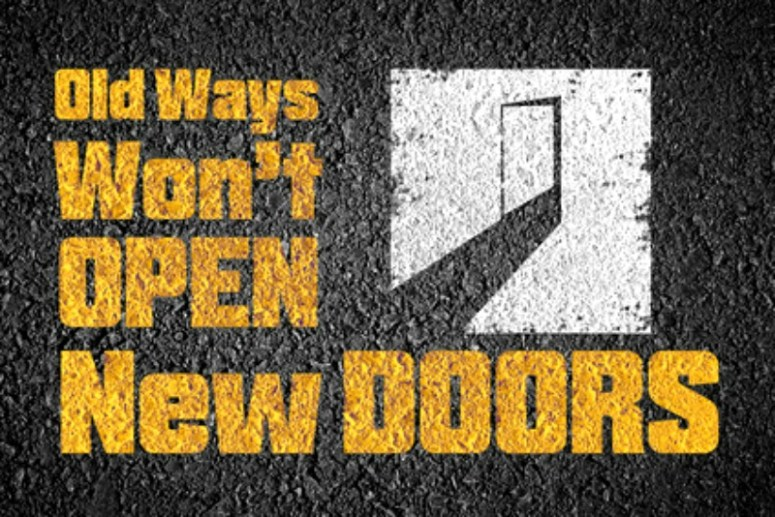 """Sign that says """"old ways won't open new doors"""""""