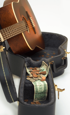 Guitar-in-case-with-money