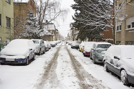 37045815 - cars parked on the street covered with fresh snow