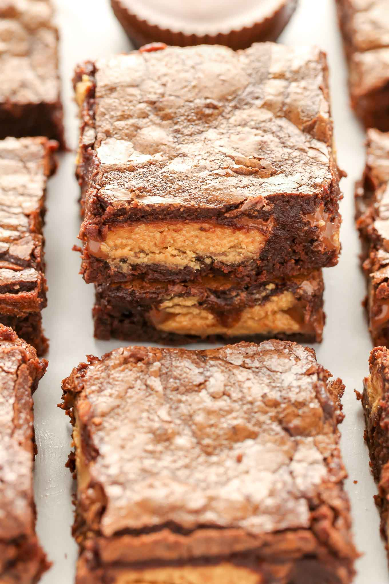 These Fudgy Peanut Butter Cup Brownies start with an easy homemade brownie recipe and are stuffed with peanut butter cups.  These fudgy brownies are the ultimate dessert!