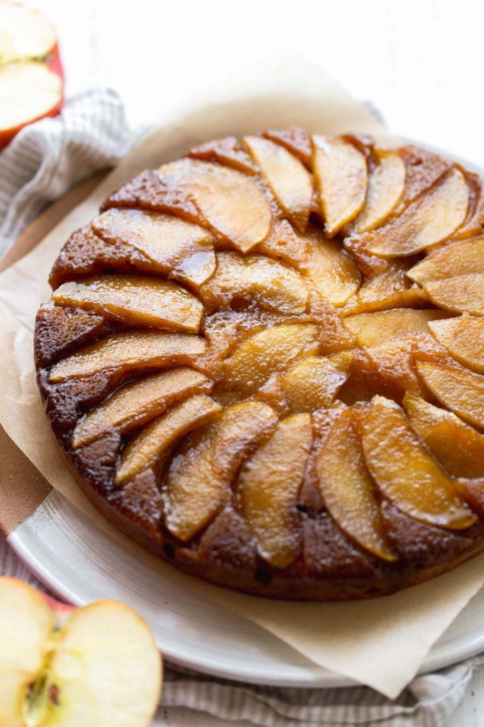 A close up image of an apple upside-down cake showing the caramelized apple topping.