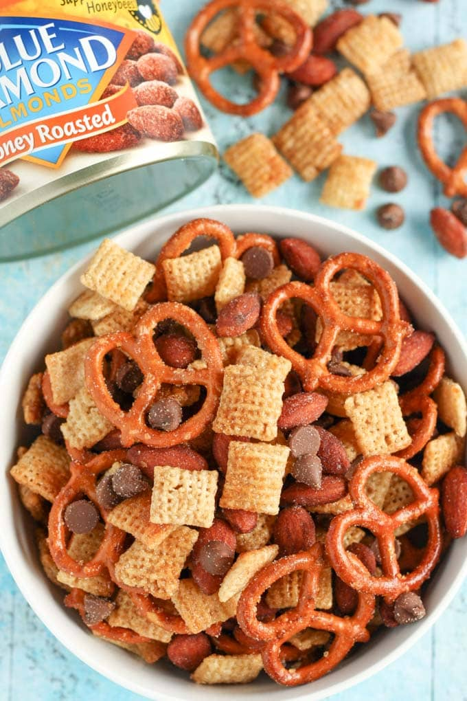 An easy to make snack mix filled with honey, pretzels, chocolate, almonds, and more! This Honey Almond Snack Mix makes a perfect snack for any party or occasion!