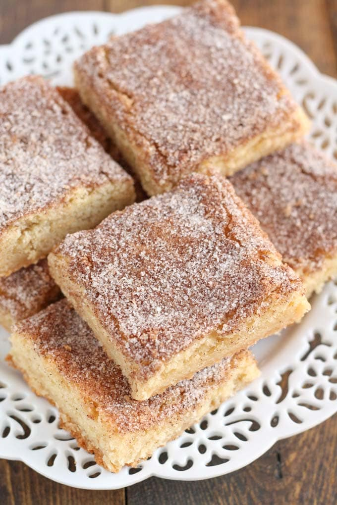 Snickerdoodle bars piled on a white plate.