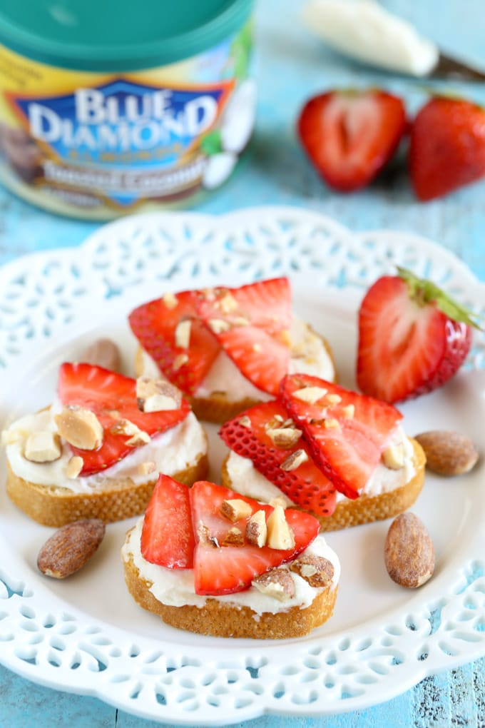 These Strawberry, Almond, and Honey Goat Cheese Crostini are so easy to make and perfect for summer!