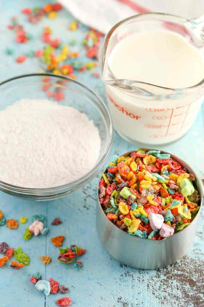 Three ingredient pudding pops filled with Marshmallow Fruity Pebbles! These Marshmallow Fruity Pebbles Pudding Pops make an easy and delicious treat!