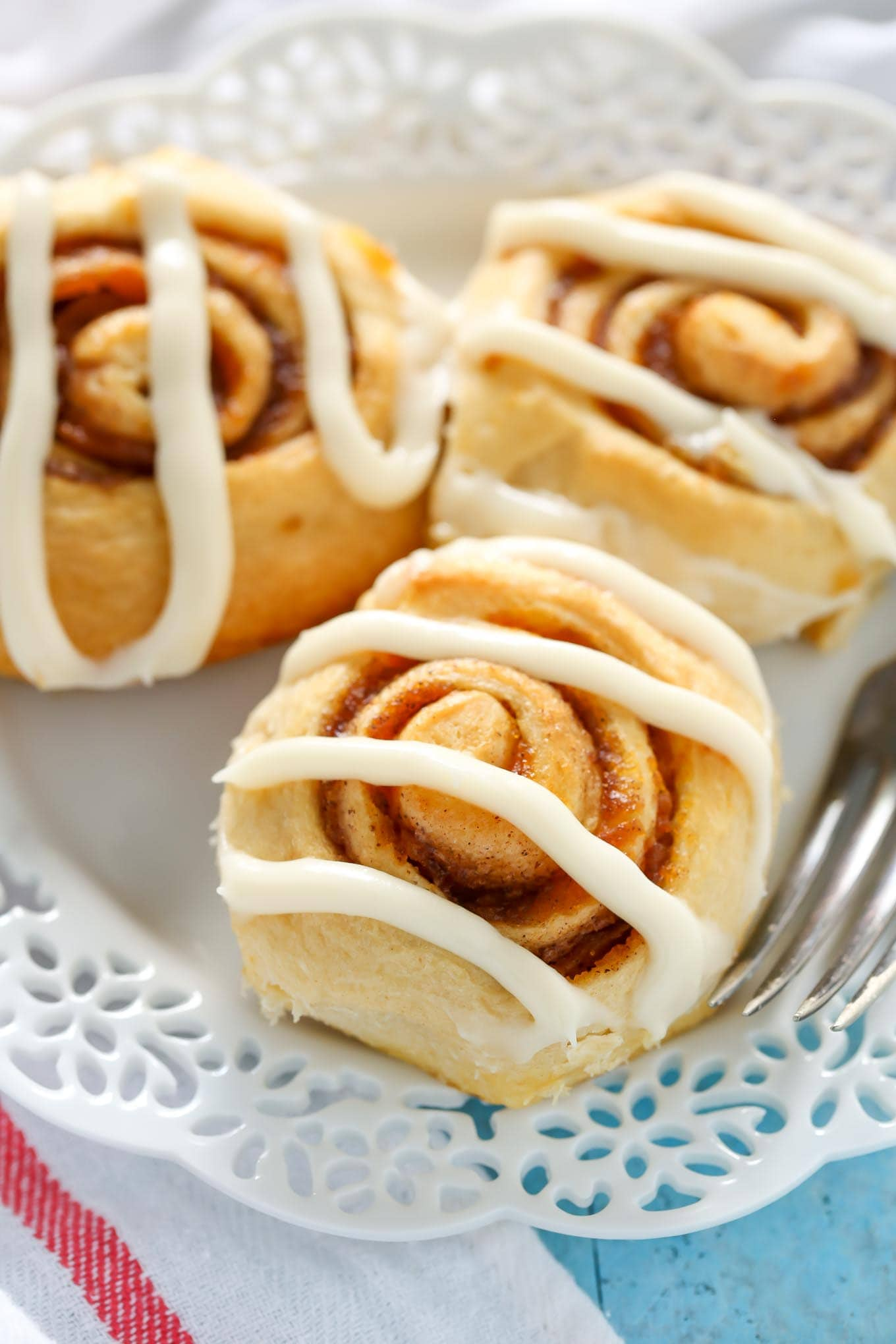 Easy Pumpkin Cinnamon Rolls made with crescent dough and topped with a homemade cream cheese frosting. The perfect fall breakfast!