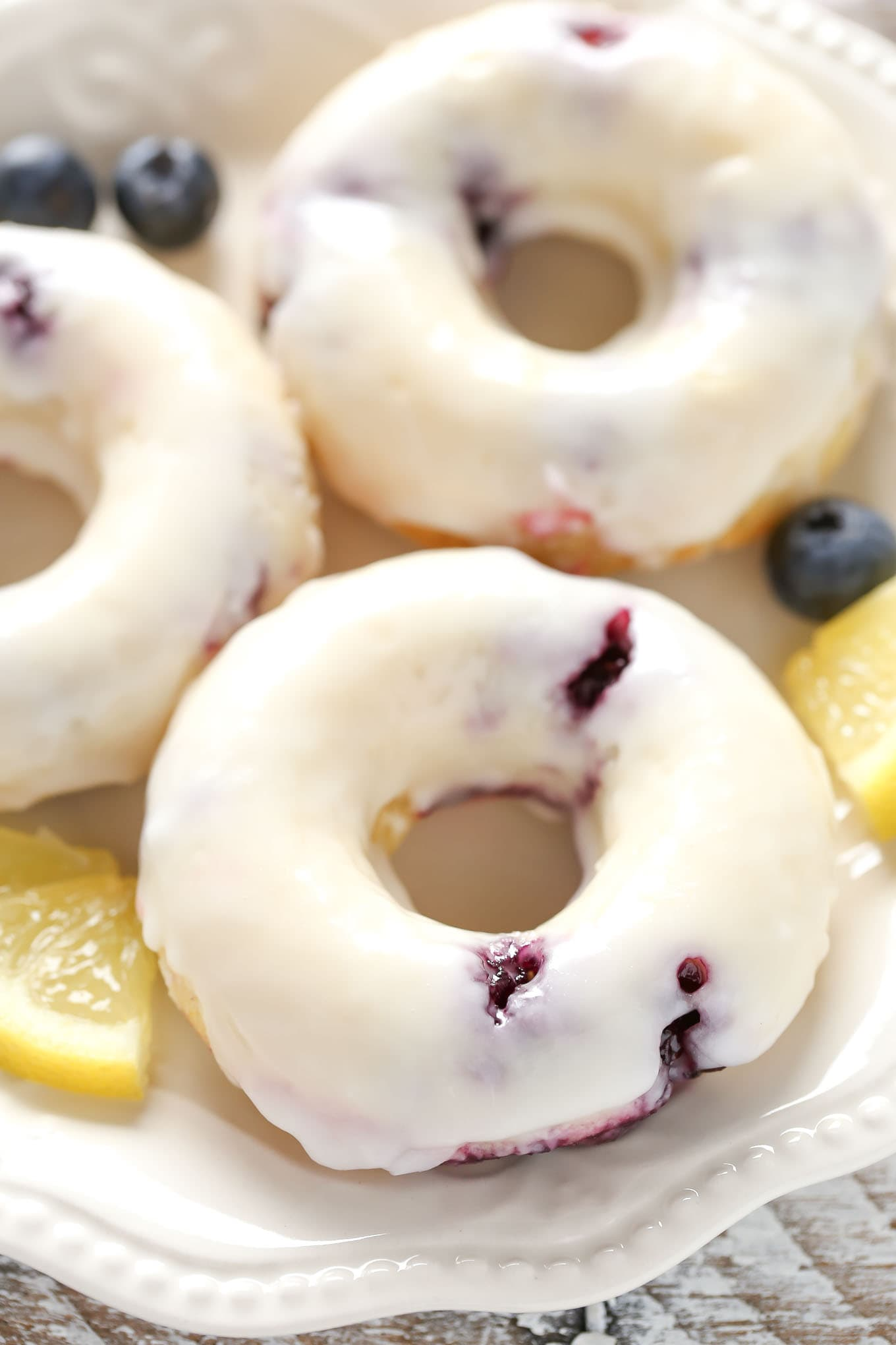 Lemon blueberry donuts topped with a simple 2-ingredient lemon glaze. These Baked Lemon Blueberry Donuts are incredibly easy to make and perfect for breakfast!