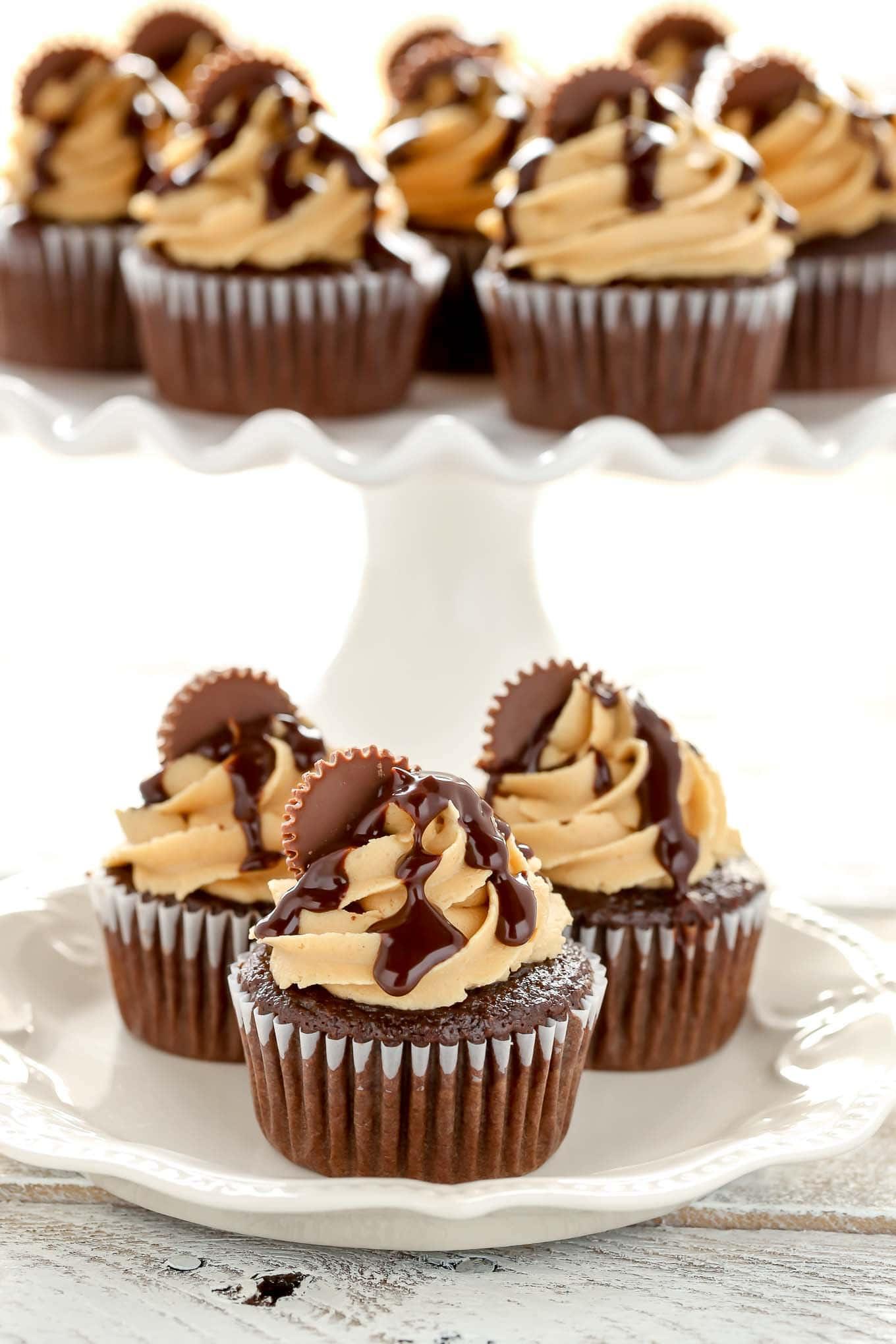 Moist chocolate cupcakes with peanut butter frosting, chocolate ganache, and peanut butter cups. These cupcakes are the ultimate chocolate and peanut butter dessert!