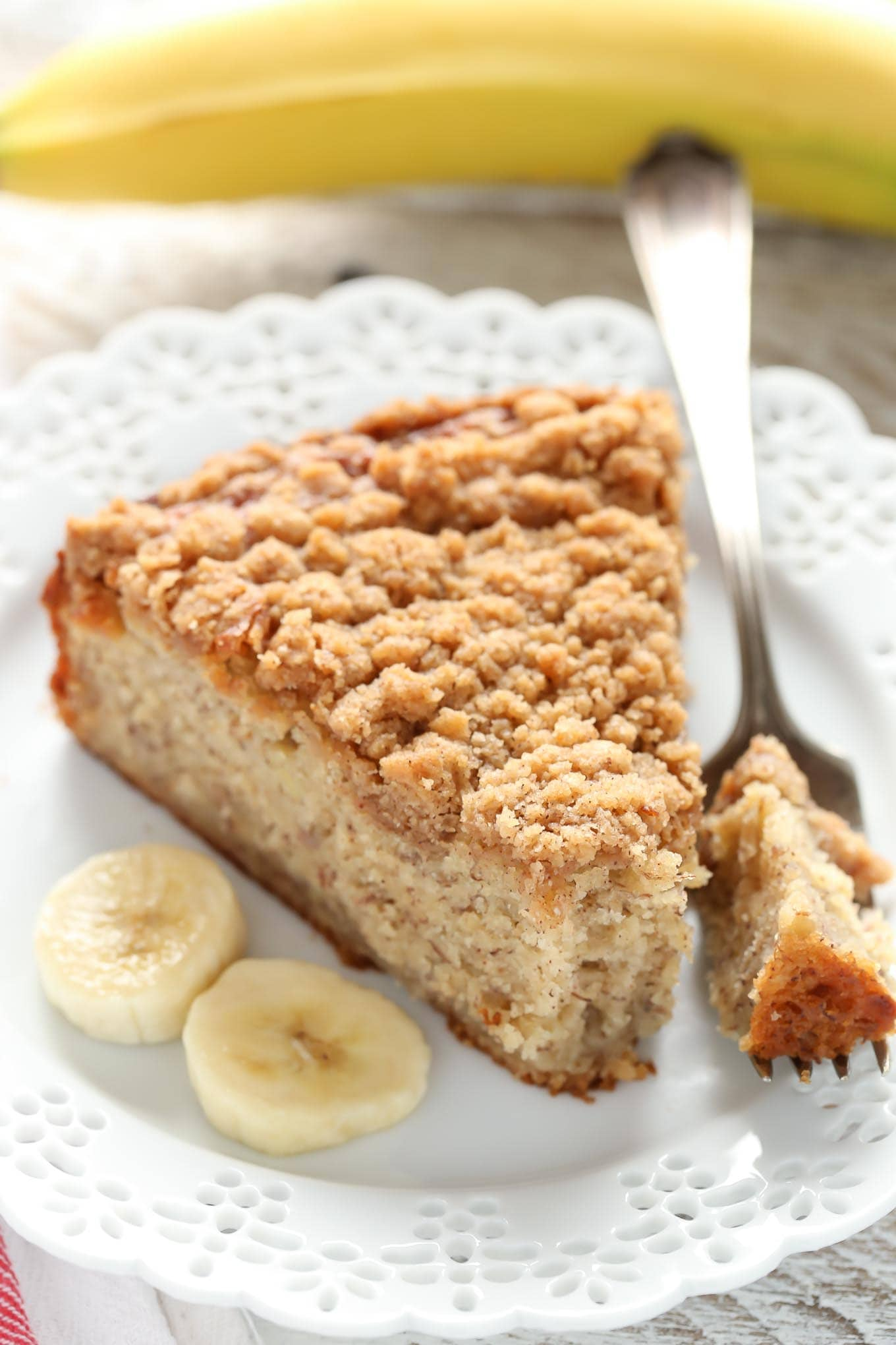 A moist banana cake topped with an easy crumb topping. This Banana Crumb Cake is a perfect way to use those ripe bananas!
